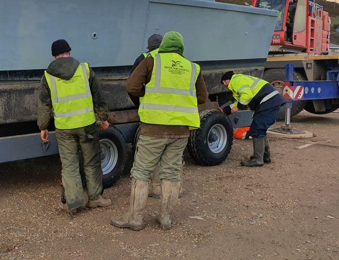 DFL Crew Securing Landing Craft On Lorry