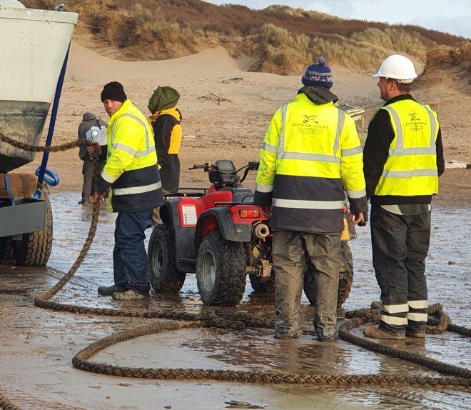 DFL Crew Securing Landing Craft On Beach